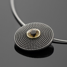 Oxidised silver pendant with a citrin
