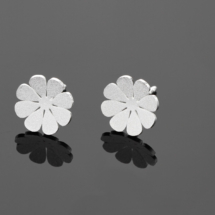 Petite and delicate silver earrings made in Mauritius