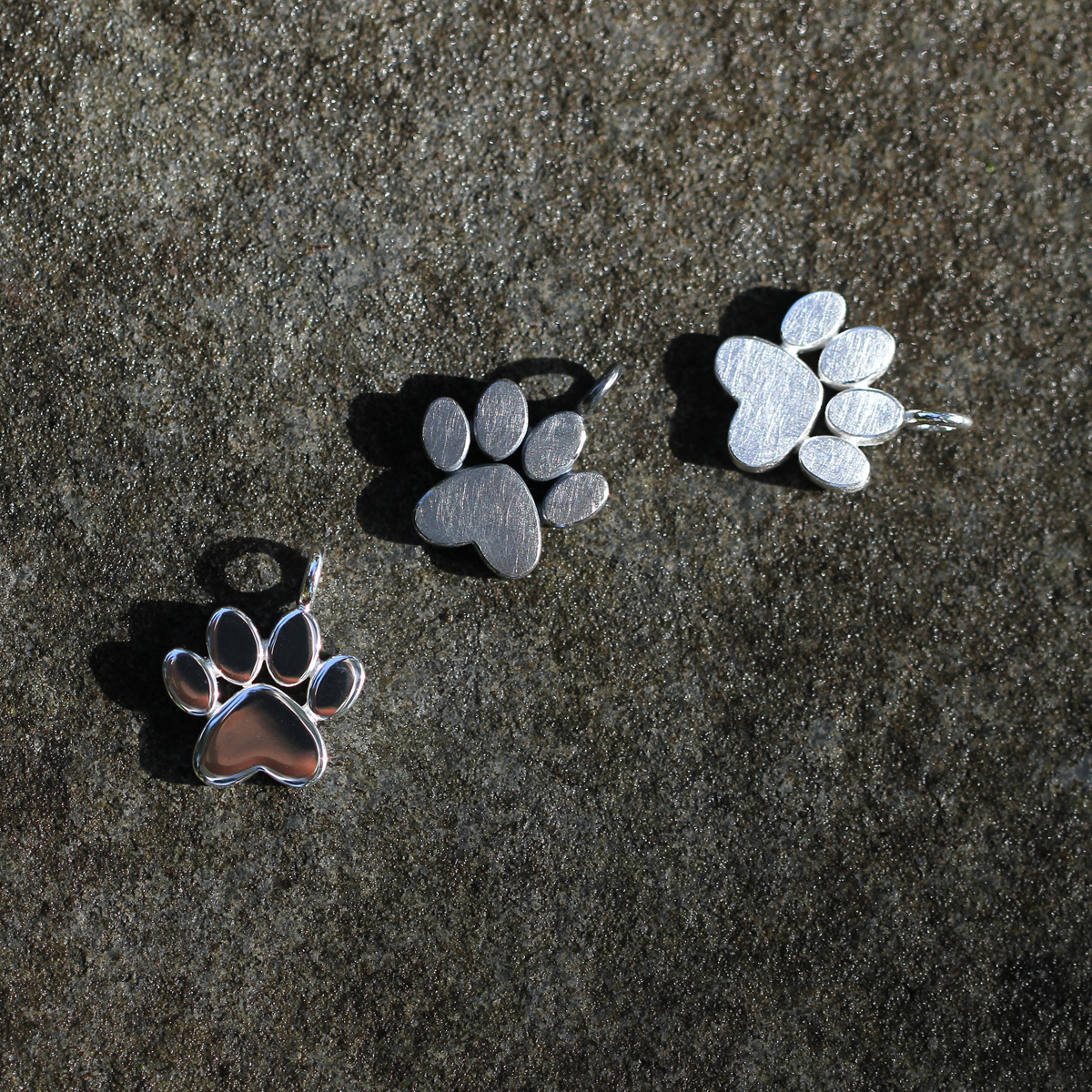 Silver paw pendants